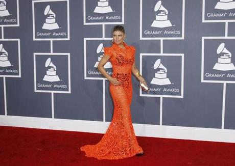 MISS - WHO: Fergie. WHERE: 54th Grammy Awards in LA on Fedb. 12. WORE: Orange Jean Paul Gaultier with black bra and granny pants.